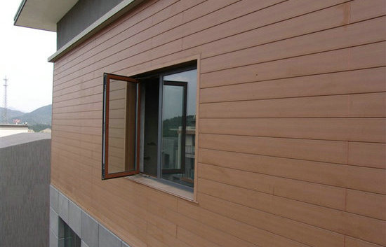 Low maintenance wood plastic composite cladding